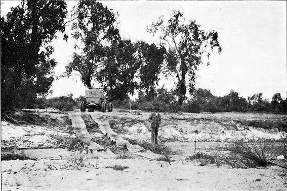 Crossing the muddy Neales River near the historic Algebuckina bridge south of Oodnadatta